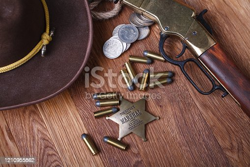istock Wild west rifle, ammunition and sheriff badge 1210955862