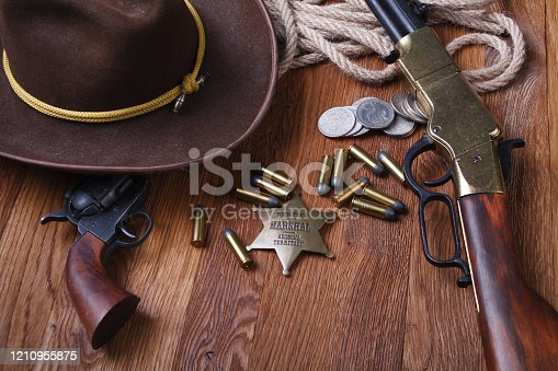 istock Wild west rifle, ammunition and sheriff badge 1210955875