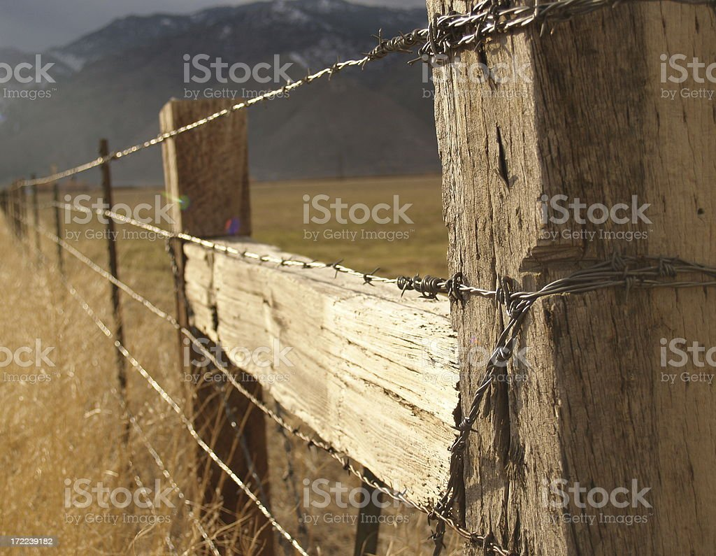 Wild West Wooden Barbed Wire Fence royalty-free stock photo