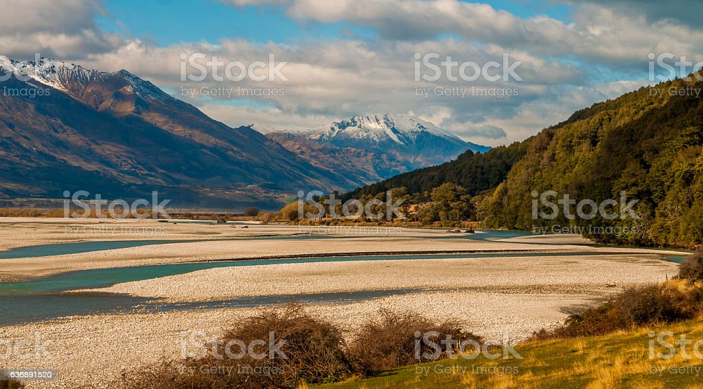 Wilderness with mountains trees and river stock photo