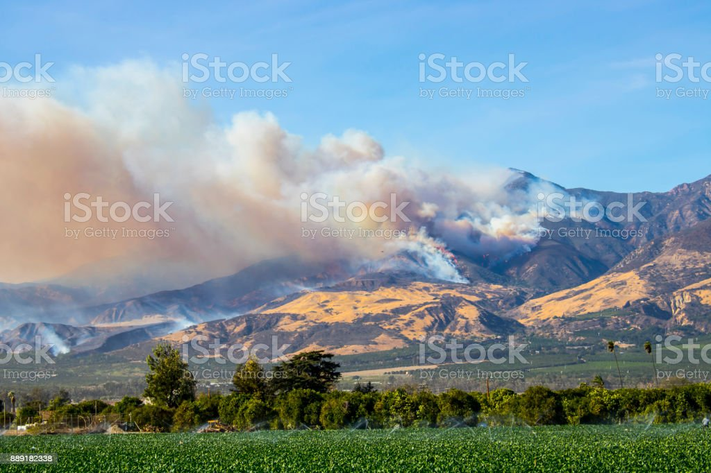 Wildfire in California Hills with Plumes of Smoke stock photo