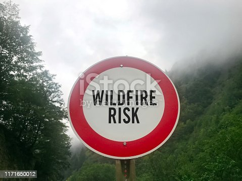 Wildfire warning sign in a forest