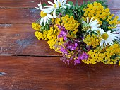 A wildflower bouquet on a wooden table