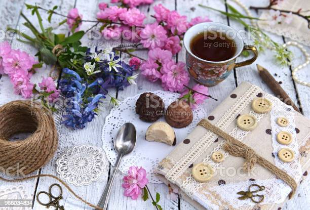 Wildflowers Cherry Tree Branches In Blossom Cup Of Tea And Diary On Planks Stock Photo - Download Image Now