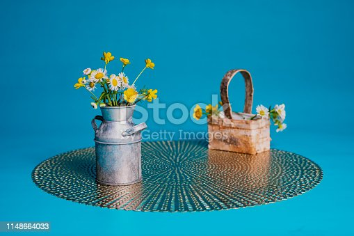 istock Wildflowers in a Miniature Milk Can 1148664033