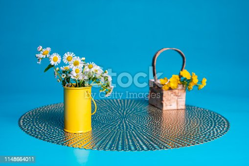 istock Wildflowers in a Small Yellow Cylinder 1148664011