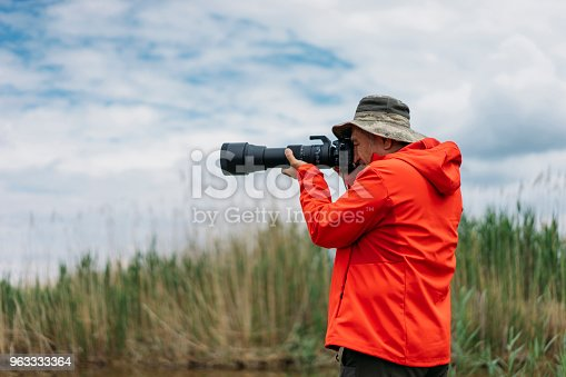 Wildlife photographer in the nature