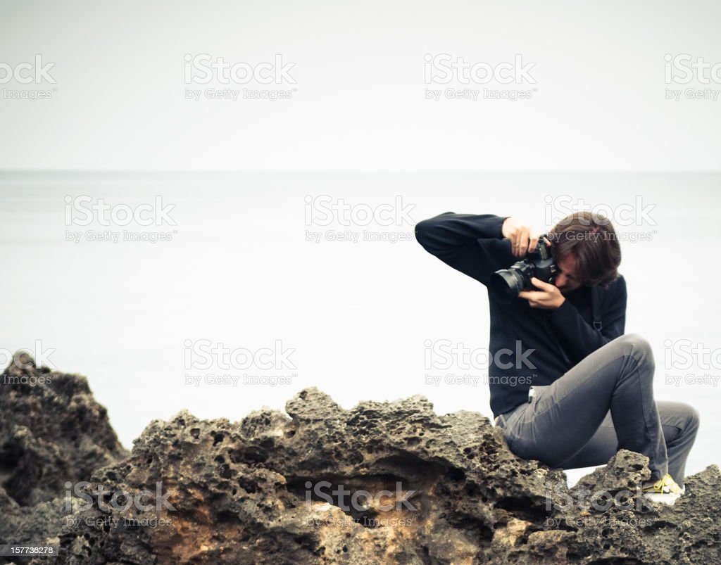 wildness photographer on the rock royalty-free stock photo