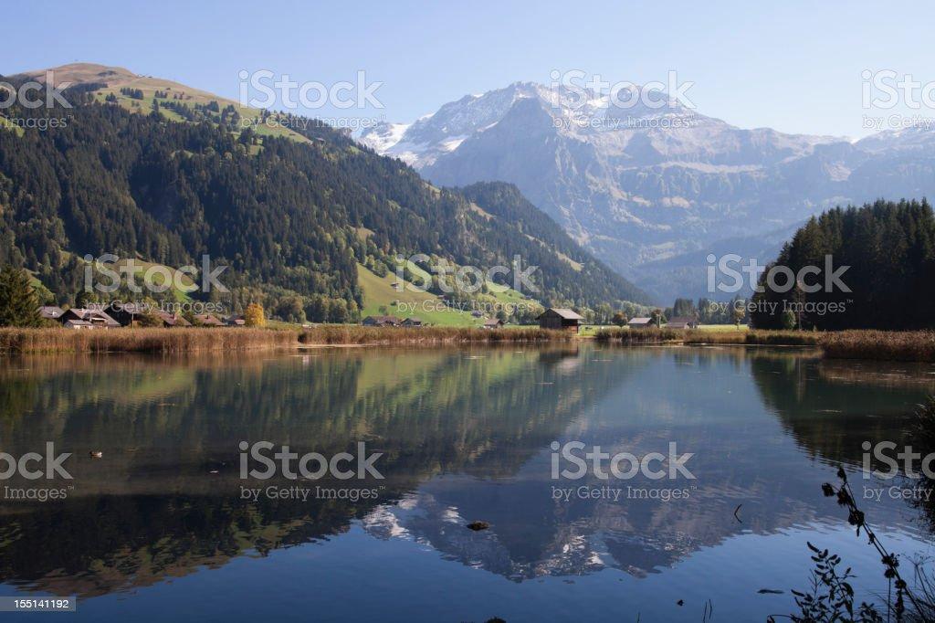 Wildstrubel Peak above Lenk, Autumn, with reflection stock photo