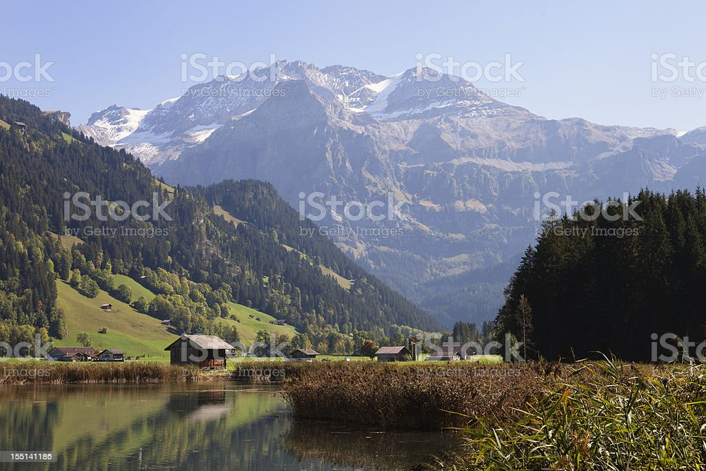 Wildstrubel Peak above Lenk, Autumn, with reflections stock photo