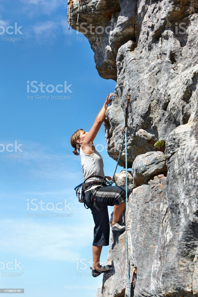 I will conquer this mountain! stock photo