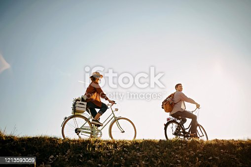Couple relaxing on the sun with bicycle in nature