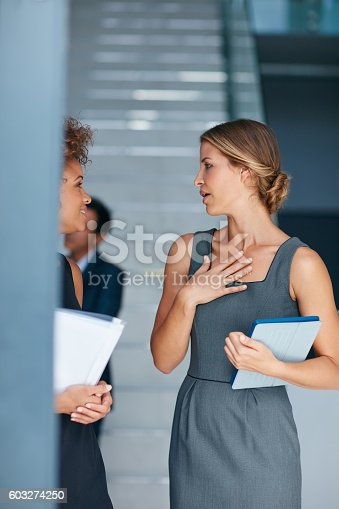 Cropped shot of two businesswomen having a discussion in an office