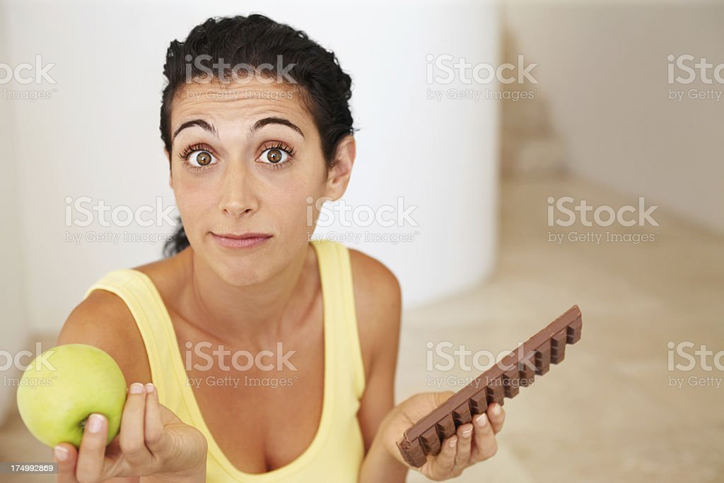 Will she make the right choice? royalty-free stock photo