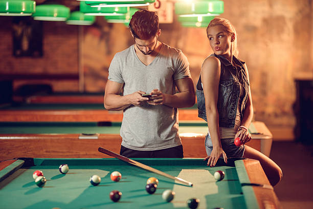 i will trick him and put the ball into hole! - bad date stock photos and pictures