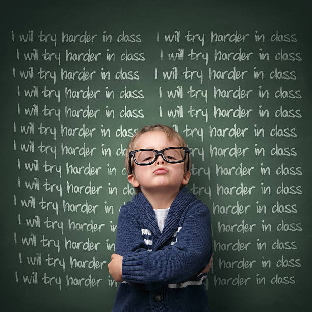 I will try harder in class Naughty schoolboy with lines written on a blackboard reading I will try harder in class. Detention and school discipline / punishment concept punishment stock pictures, royalty-free photos & images