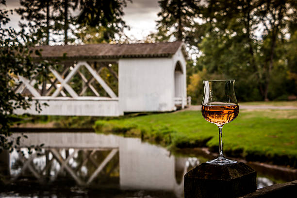 Willamette Valley Wine Glass Rosé Reflections Oregon Covered Bridge stock photo