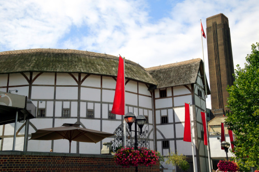 William Shakespeare Globe Theatre which is situated beside the River Thames on London's South Bank opposite St Paul's Cathedral and next to the Tate Modern in England
