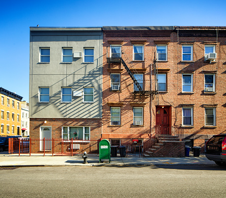 Williamsburg apartment buildings with steel fire escape stairway and letter box