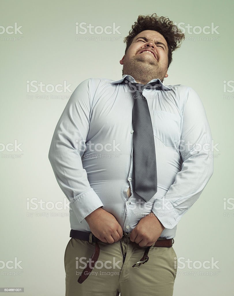 Willing his pants closed stock photo