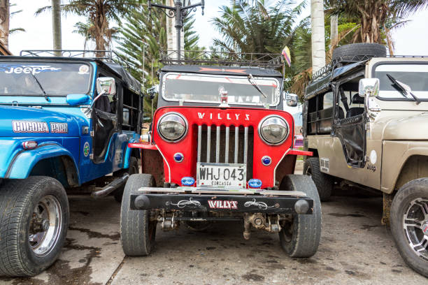 Willys Jeep in Salento, Colombia SALENTO, COLOMBIA - JUNE 6: Red Willys Jeep in the plaza in Salento, Colombia on June 6, 2016 willys stock pictures, royalty-free photos & images