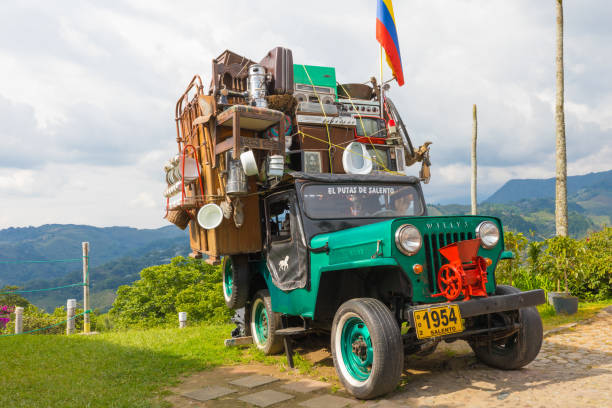 Willys jeep with moving cargo Salento Colombia Salento March 2018 This Willys Jeep of the 60s is used by Colombian who live in the coffee production area to transport their belongings from one place to another willys stock pictures, royalty-free photos & images