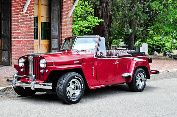 Willys Overland VJ2 Jeepster Columbia, California, USA - June 25, 2013:  A 1948 WIllys Overland VJ2 Jeepster on the street of the Columbia State Park in Columbia, California willys stock pictures, royalty-free photos & images