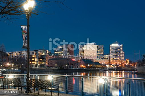 WILMINGTON, DE - APRIL 5, 2018: Wilmington, Delaware Riverwalk and Skyline  along the Christiana River at night