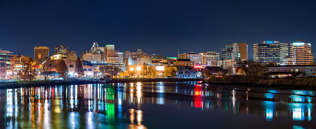 Wilmington skyline panorama by night, reflected in Christiana River. Wilmington is the largest city in the state of Delaware.