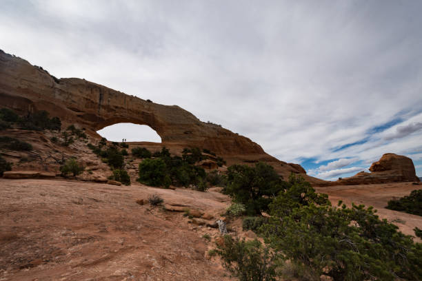 Wilson Arch, located in Dry Valley Utah, is an entrada standstone rock formation in the desert Wilson Arch, located in Dry Valley Utah, is an entrada standstone rock formation in the desert entrada sandstone stock pictures, royalty-free photos & images