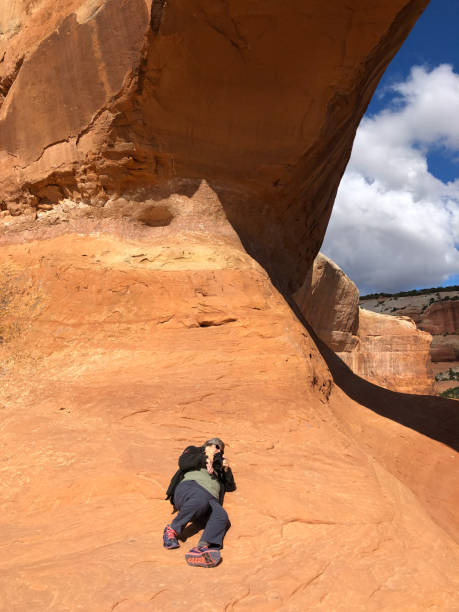 Woman Photographing Wilson Arch stock photo