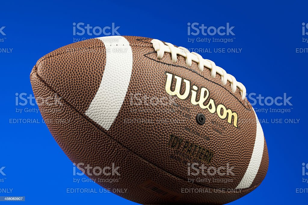 Wilson Football With Deep Blue Background royalty-free stock photo