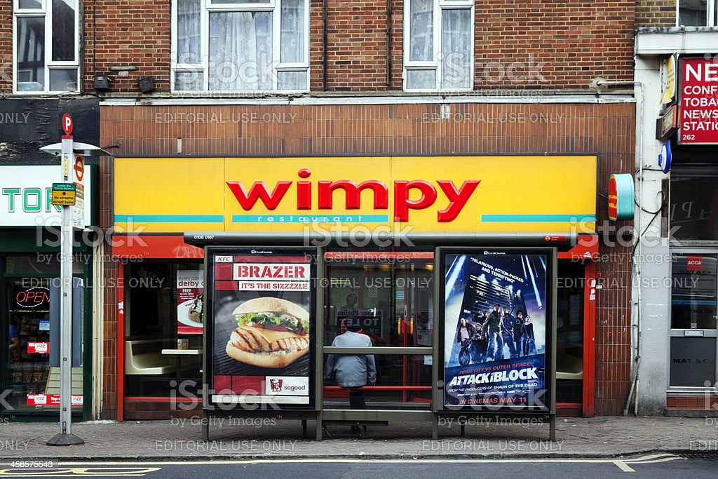 Wimpy restaurant shop front with bus stop stock photo