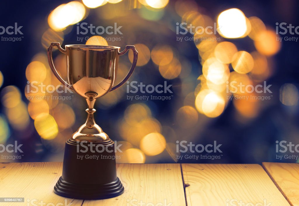 Win prize trophy on wood table with background window. stock photo