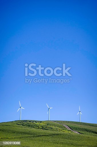 Win Turbine generator at a wind farm. Renewable Energy Plants.