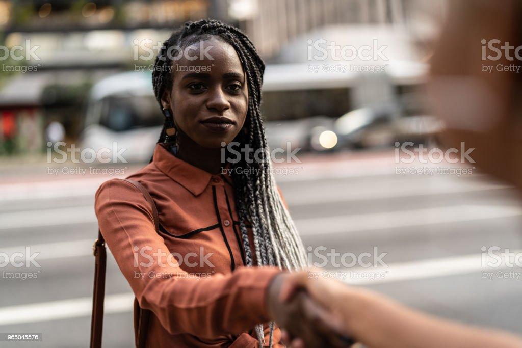 Businesswomen shaking hands in meeting at city zbiór zdjęć royalty-free