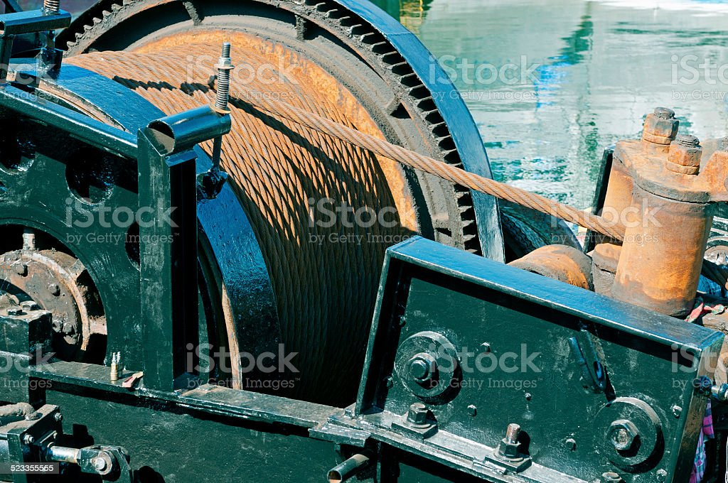 Winch and cable for hauling in fishing net on trawler stock photo