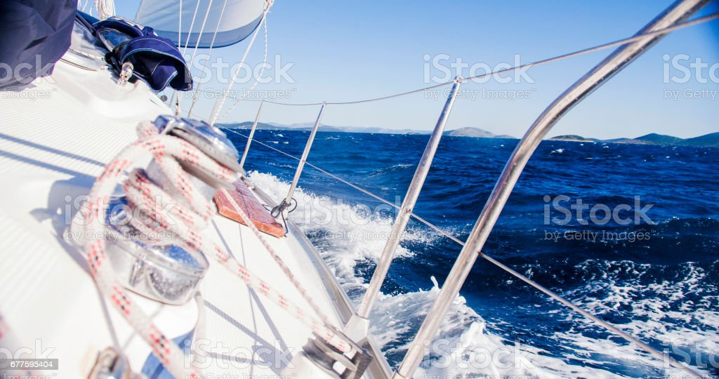 Winch with rope on sailing boat in sea royalty-free stock photo