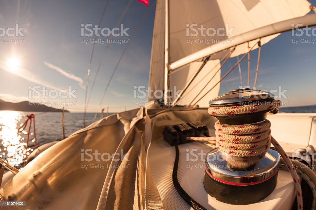 Winch with rope on sailing boat stock photo