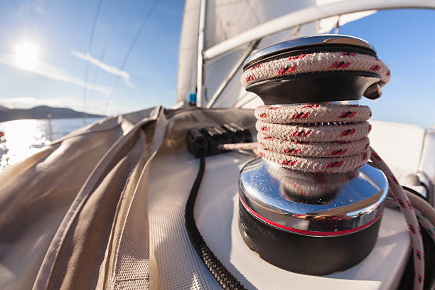 Winch with rope on sailing boat Winch with rope on sailing boat in the sea rigging stock pictures, royalty-free photos & images