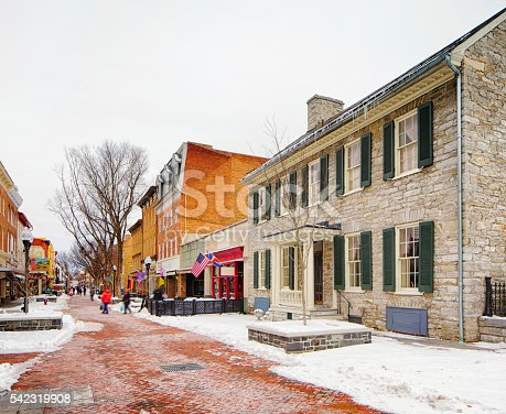 Winchester old town in Winter commercial section. The bricked road is line with stores and restaurants.