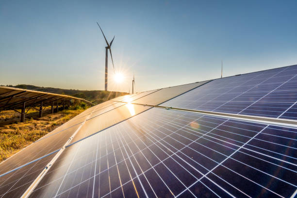 Wind and solar power stations stock photo