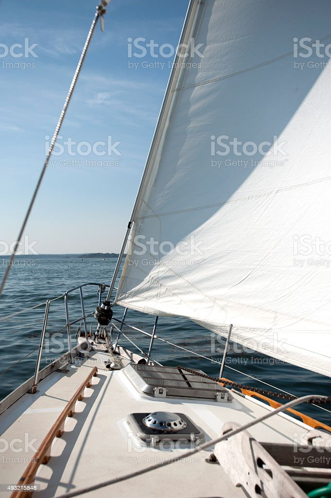Wind and sun on a sailboat stock photo