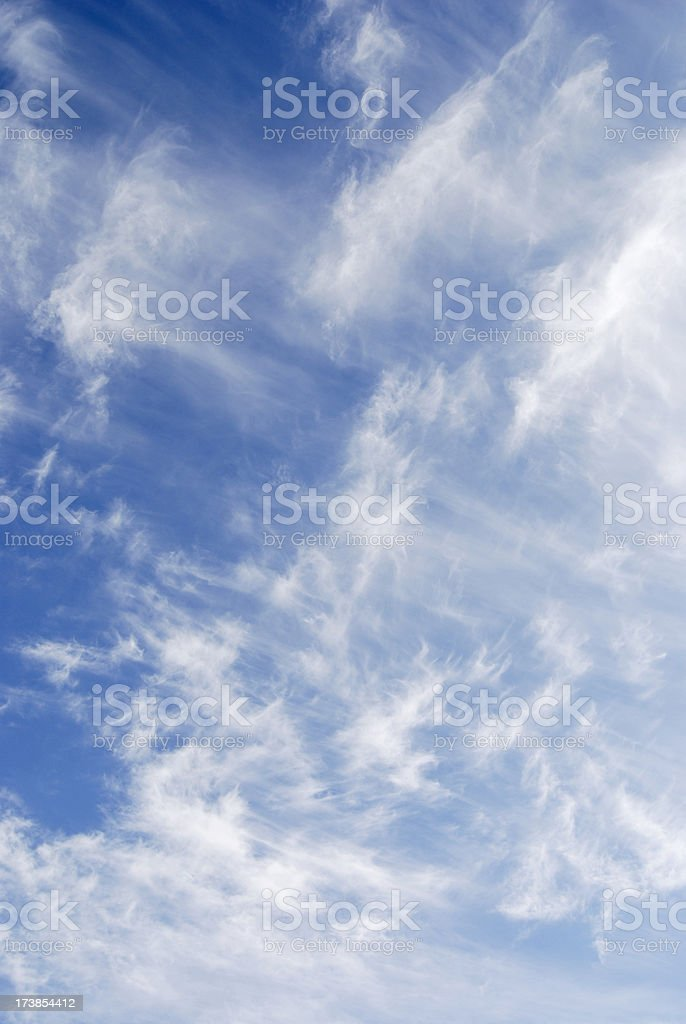 wind blown clouds background stock photo