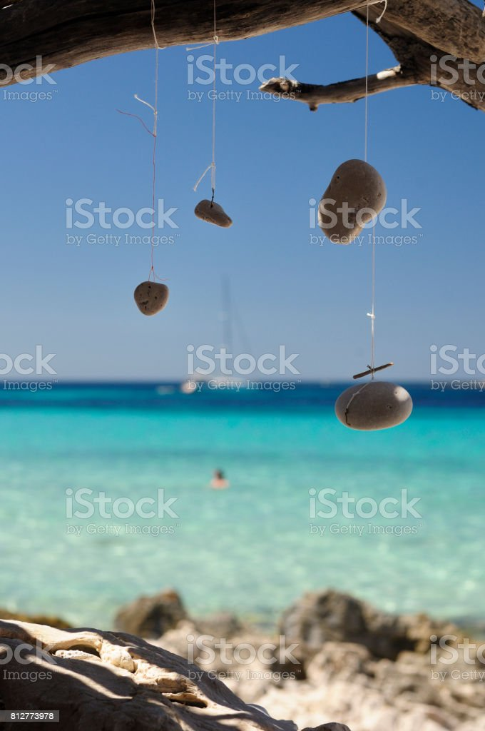 Wind Chime and dream catcher by the sea stock photo