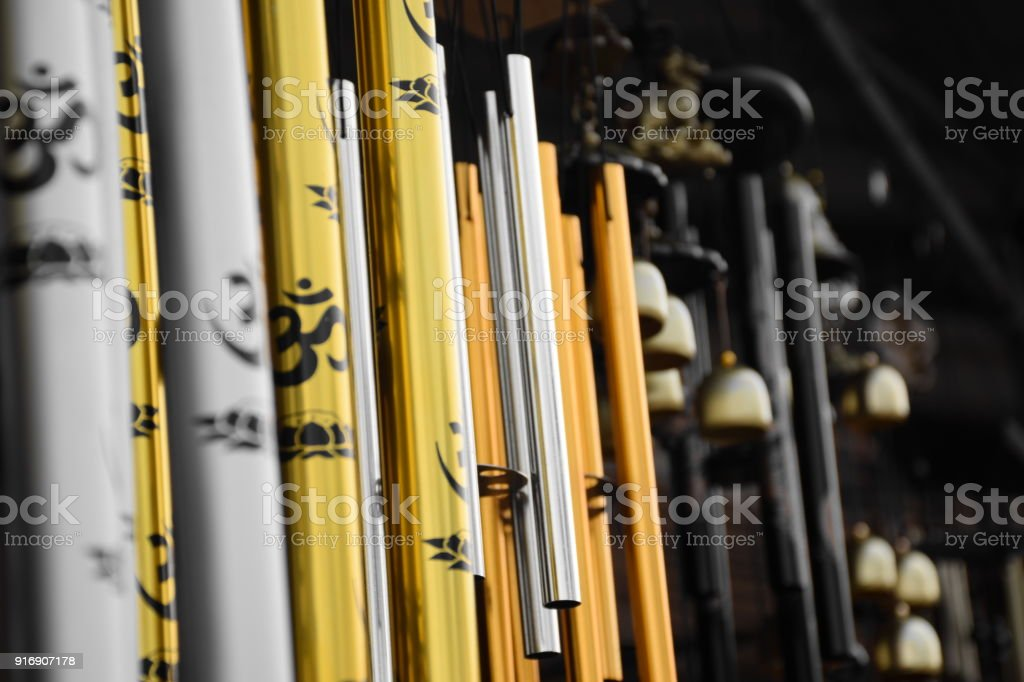 Wind chimes hanging in a roadside shop stock photo