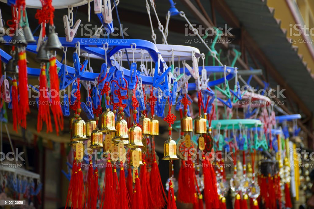 Wind chimes with writings from unknown language (non-english) on them stock photo