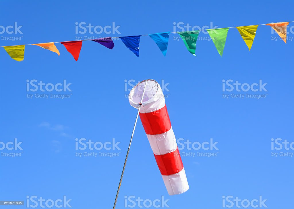 Wind cone and colored flags photo libre de droits