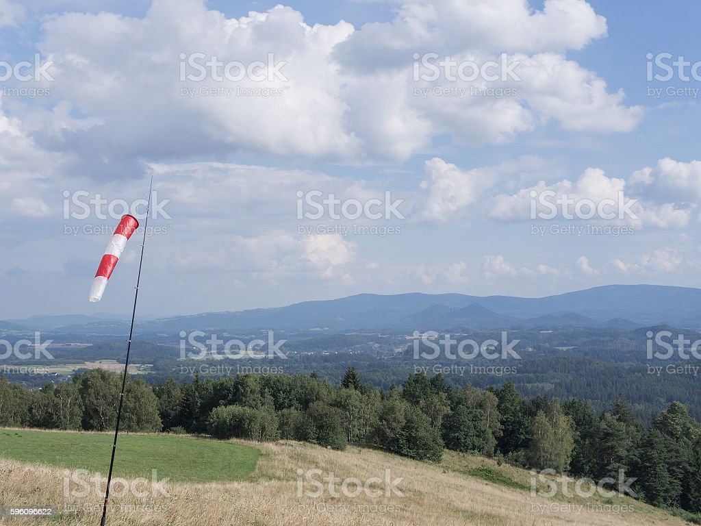 Wind Cone In A Hilly Landscape With Forest Lizenzfreies stock-foto
