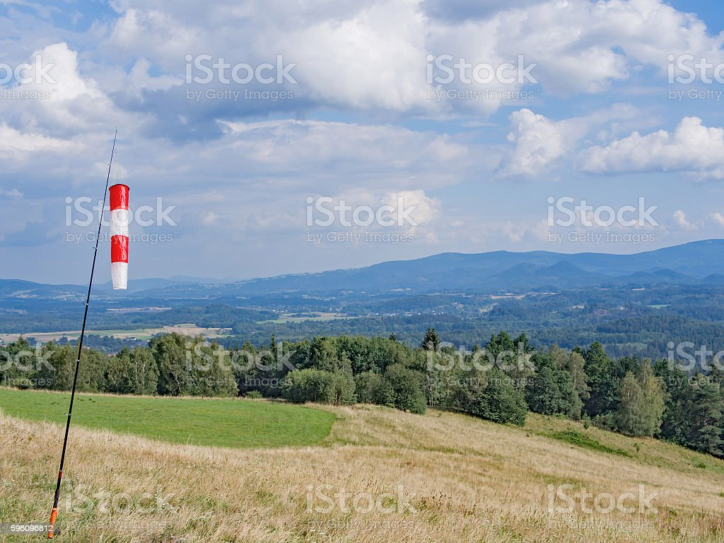 Wind Cone In A Hilly Landscape With Forest royalty-free stock photo